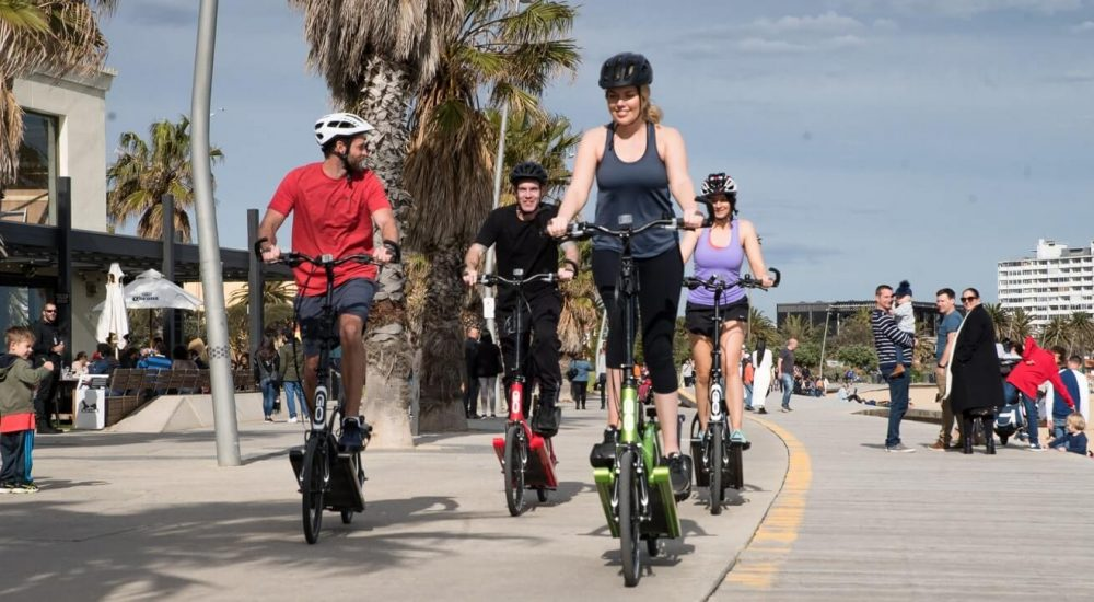 A group of people riding elliptigos in melbourne